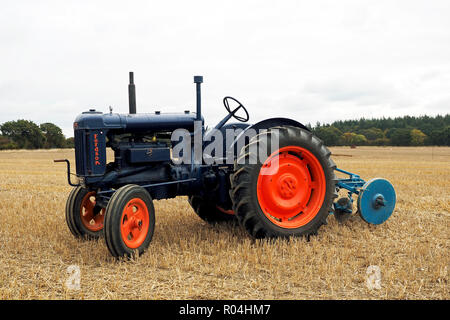 A Fordson E27N Major tractor with plough at a country fair in Norfolk, England. - Stock Image