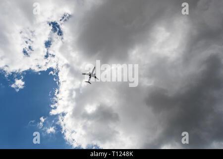 Plane in the sky - Stock Image