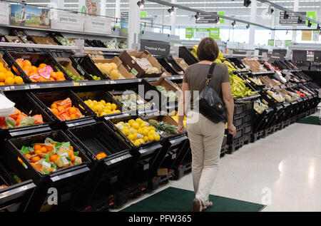 A model released customer shopping in the fruit and veg Asda supermarket aisle, Asda, Bury St Edmunds, Suffolk UK - Stock Image