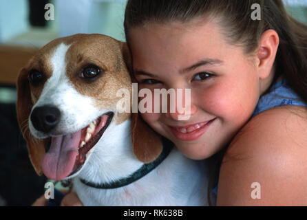 Young girl and Her Pet Beagle Smile for the Camera, USA - Stock Image