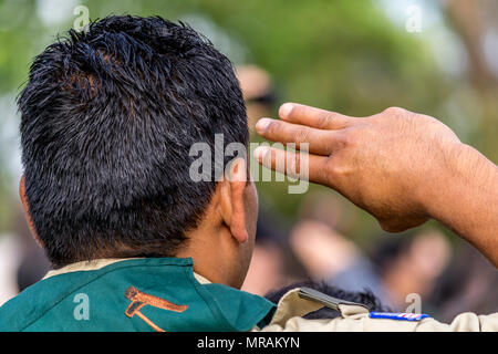 Los Angees, California USA 26 May 2018 Boy Scouts place flags on Veteran's graves to honor them on Memorial Day. This Scout is giving the Scout Salute Credit: Chester Brown/Alamy Live News - Stock Image