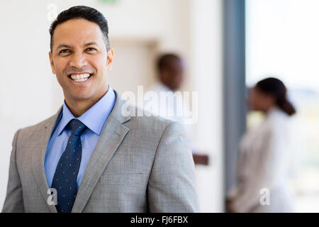 good looking mid age business leader in office - Stock Image