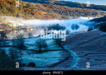 Low mist above Rydal Water, seen from near Banneriggs, near Grasmere, Lake District, Cumbria - Stock Image