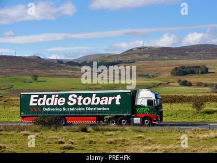 Eddie Stobart HGV. Delivering Sustainable Distribution. M6 Northbound carriageway, Shap, Cumbria, England, United Kingdom, Europe. - Stock Image