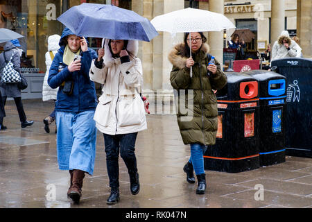 Bath, UK. 8th February, 2019. As storm Eric brings gales and heavy rain across the UK pedestrians shopping in the centre of Bath are pictured carrying umbrellas as they brave the heavy rain and wind. Credit: Lynchpics/Alamy Live News - Stock Image