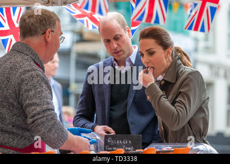 The Duke and Duchess of Cambridge meet traders during a walkabout in Keswick town centre as part of a visit to Cumbria. - Stock Image