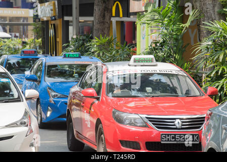 Taxis parked and waiting on Orchard Road in the central Singapore shopping district - Stock Image