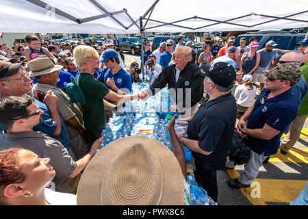 Panama City, Florida, USA. 15th Oct 2018. U.S President Donald Trump greets victims of Hurricane Michael at a FEMA assistance center October 15, 2018 in Lynn Haven, Florida. Credit: Planetpix/Alamy Live News - Stock Image