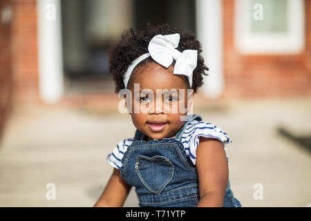 Happy African Amereican little girl laughing and smiling. - Stock Image