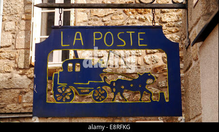 a la Poste postoffice signpost in the historic picturesque medieval town of Moncontour, Brittany,  Northern France. - Stock Image