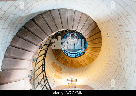 Penmarch, France - August 2, 2018: Spiral staircase in Eckmuhl Lighthouse in Brittany. Directly below view - Stock Image