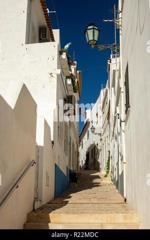 A Narrow Residential Street In The Old Town Of Albufeira The Algarve Portugal - Stock Image