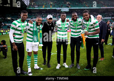 Celtic's Vakoun Issouf Bayo (left), Olivier Ntcham, Eboue Kouassi, Odsonne Edouard and Dedryck Boyata celebrate on the pitch after winning the Ladbrokes Scottish Premiership match at Celtic Park, Glasgow. - Stock Image