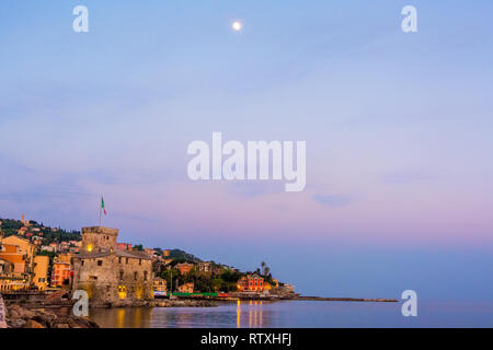 panorama italian sea village space text and moon high in the sky - Rapallo italy sea town copy space background night sunset - Stock Image