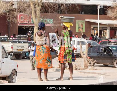 Africa, Namibia, Opuwo. Himba women outside town grocery store. Credit as: Wendy Kaveney / Jaynes Gallery / DanitaDelimont.com - Stock Image