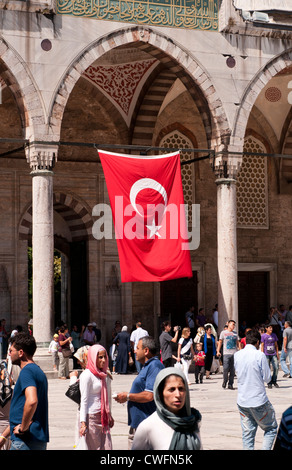 Tourists and worshippers at the northern portico to the courtyard of the Blue Mosque, Sultanahmet, Istanbul, Turkey - Stock Image