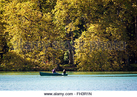 Young couple on a boat in autumn - Stock Image
