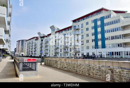 Modern purpose build apartments and flats along Millennium Promenade by Bristol Harbourside near city centre, England - Stock Image