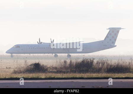 Croatia airlines turbo-prop airliner aircraft landing run - Stock Image