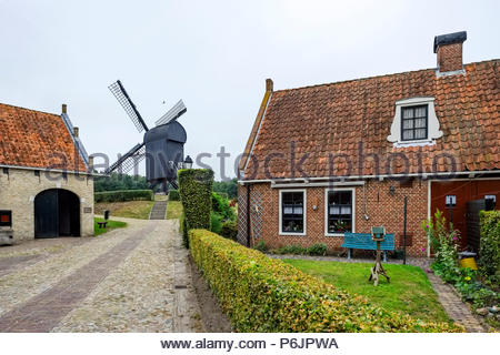 Houses and windmill at Vesting Bourtange, the star-shaped fortress in Groningen Province, The Netherlands - Stock Image