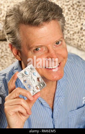 Happy Senior man Showing off Number of Times He's used ED Pills , USA - Stock Image