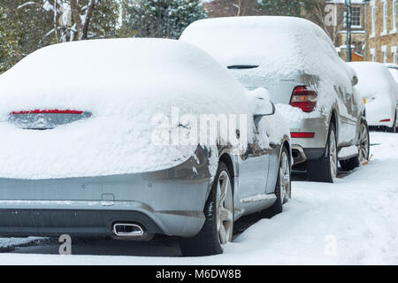 Cars covered with snow during winter - Stock Image