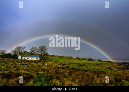 Ardara, County Donegal, Ireland. 19th March 2019. A rainbow appears on a day of sunshine and showers on the north-west coast. Credit: Richard Wayman/Alamy Live News - Stock Image