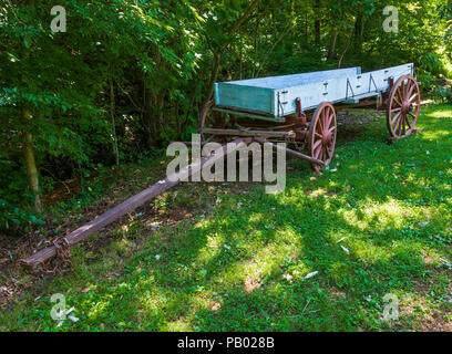 GOLDEN POND, KENTUCKY, USA-30 JUNE 18: An antique farm wagon sets at The Homeplace,  a replica of a complete 1850ish working farm. - Stock Image