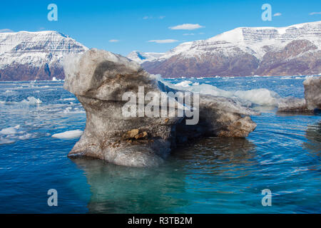 Greenland. Scoresby Sund. Gasefjord. Krogen. Dirty iceberg from the bottom of a glacier. - Stock Image