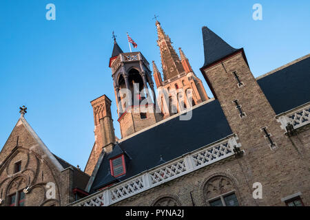 Church of Our Lady Bruges, with tower bathed in early morning light, a landmark in the medieval city of Bruges (Brugge), Belgium. - Stock Image