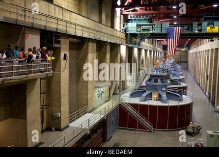 Visitors view Hoover Dam's upper generator room while taking a guided tour of the structure on the Nevada and - Stock Image