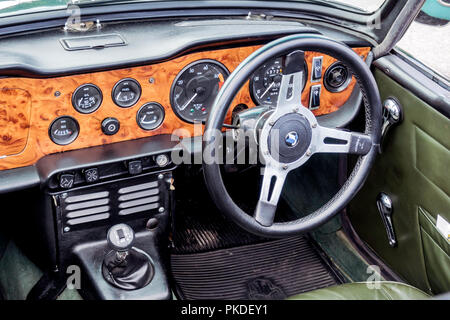 CCockpit of a 1970 Triumph TR6 sports car at an Historic Motor Gathering in September 2018 at Saltburn Cleveland UK - Stock Image