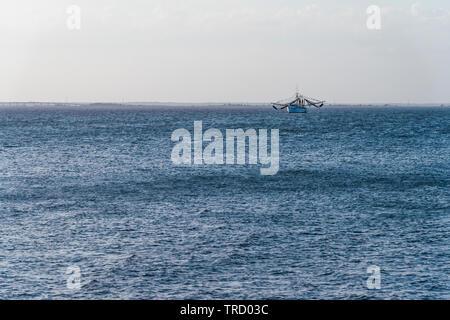 Fishing Trawler as seen from Jekyll Island, Georgia USA - Stock Image