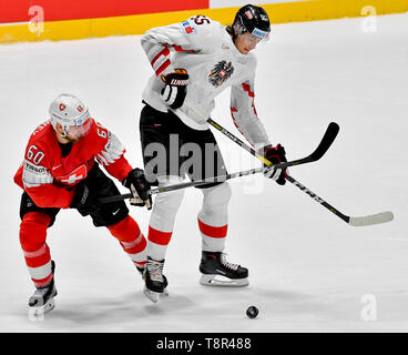 Bratislava, Slovakia. 14th May, 2019. L-R TRISTAN SCHERWEY (SUI) and RAPHAEL WOLF (AUT) in action during the match Switzerland against Austria at the 2019 IIHF World Championship in Bratislava, Slovakia, on May 14, 2019. Credit: Vit Simanek/CTK Photo/Alamy Live News - Stock Image