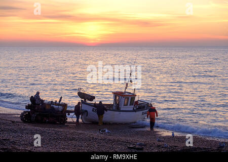 Hastings, East Sussex, UK. 14th Feb, 2019. Hastings fishing boat being launched at sunrise. Hastings has the largest beach-launched fishing fleet in Europe. - Stock Image