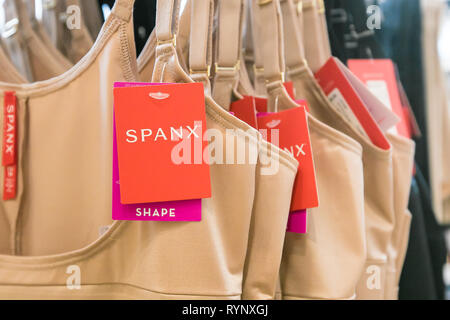 Spanx underwear hangs on display in a store. - Stock Image