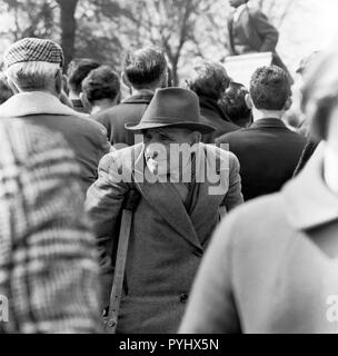 An elderly male invalid attending a political rally at Hyde Park London in the 1960s.. - Stock Image