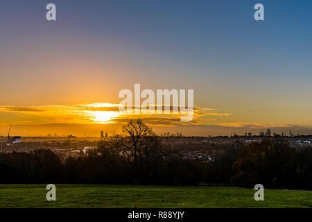 Sunrise over the London skyline from Alexandra Palace Park, London, UK - Stock Image