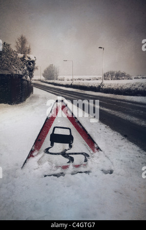 road sign in the snow - Stock Image