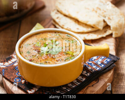 Curried Mung Bean Soup with Naan Breads - Stock Image