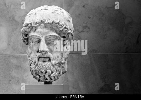 Classical ancient Greek sculpture, man's head. - Stock Image