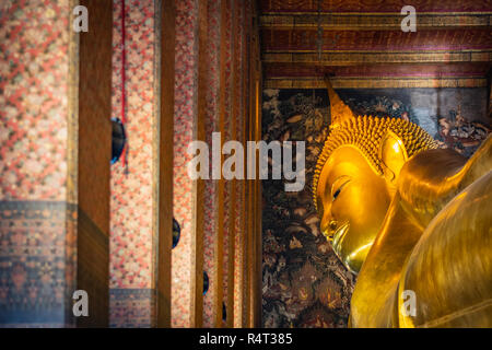 Statue of Sleep Buddha or Reclining Buddha in Wat Pho Temple in Bangkok, Thailand - Stock Image