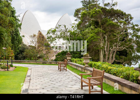 Gardens of Government house in Sydney and the Sydney Opera House building,Sydney, Australia - Stock Image