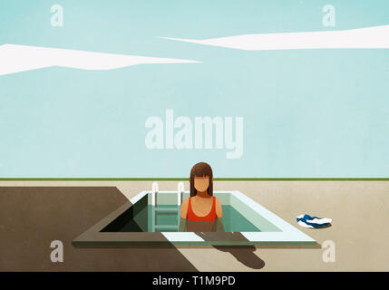 Woman standing in small swimming pool - Stock Image