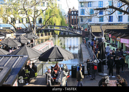 The bridge over Regents Canal from Camden Market, in spring sunshine, in north London, UK - Stock Image