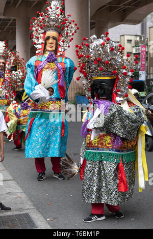 The Seventh Lord or General Xie, left, and the Eighth Lord or General Fan, right, two gods in the daoist pantheon in a taoist parade in Taipei. - Stock Image