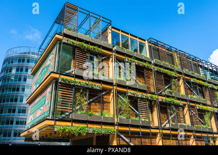 The Pavilion, a timber framed building hosting The Ivy restaurant, Spinningfields, Manchester, UK - Stock Image