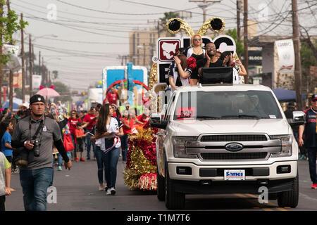 Pickup truck pulls float through streets of Laredo, Texas, during annual Washington's Birthday Celebration parade. - Stock Image
