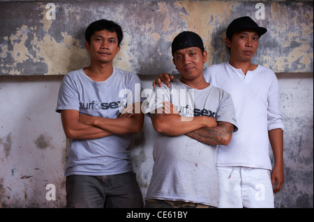 Three Balinese brothers, Ubud Indonesia - Stock Image