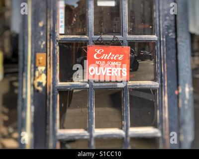 Open sign on a French store in Brussels, Belgium - Stock Image